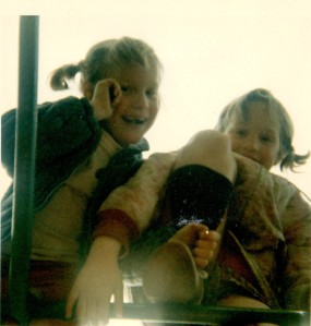Amy and Lib on jungle gym, date unknown