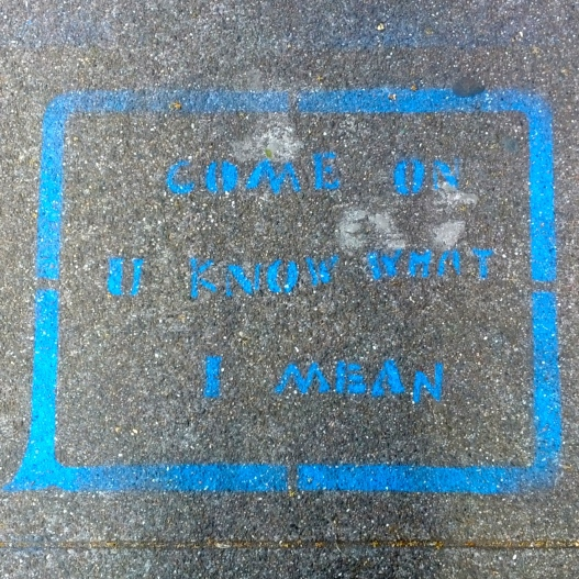 Blue text, grey sidewalk, March 20, 2015