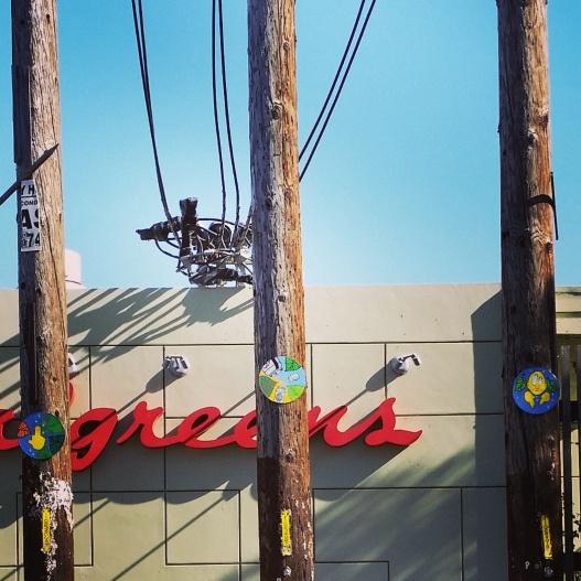 Three painted discs, three telephone poles, June 16, 2015